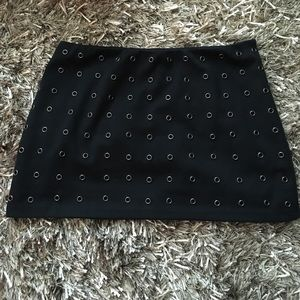 Black rayon mini skirt with metal eyelets